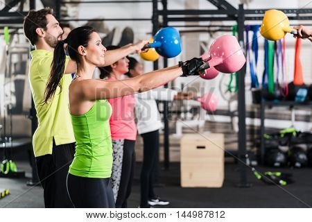 Functional fitness workout in sport gym with kettlebell