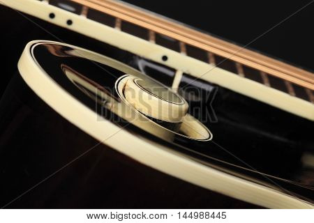 Mandolin isolated on black background detail on strings