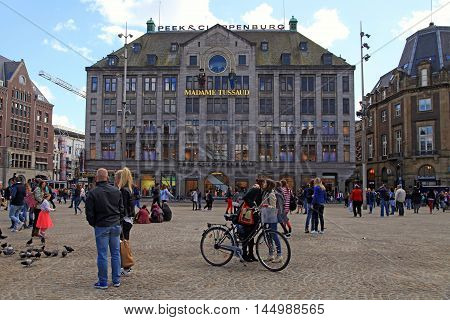 AMSTERDAM, NETHERLANDS - MAY 3, 2016: Tourists near Madame Tussauds wax museum in Amsterdam, Netherlands. It is a major tourist attraction in Amsterdam displaying waxworks of famous figures.