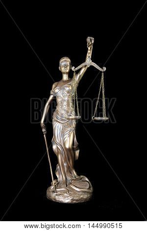 Lady Justice or Themis isolated on black background