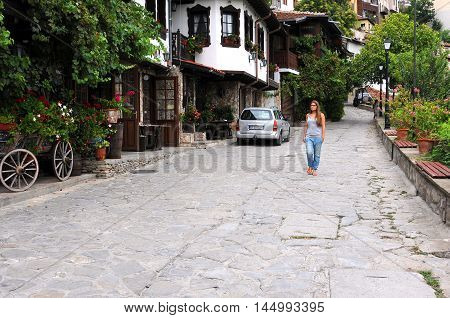 VELIKO TARNOVO BULGARIA - AUGUST 24 2016: Unidentified Caucasian girl walks down General Gurko Street