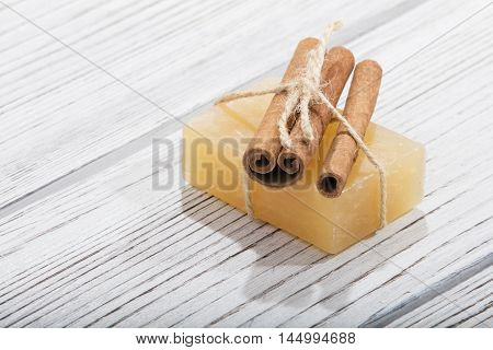 handmade soap with cinnamon on the wooden background
