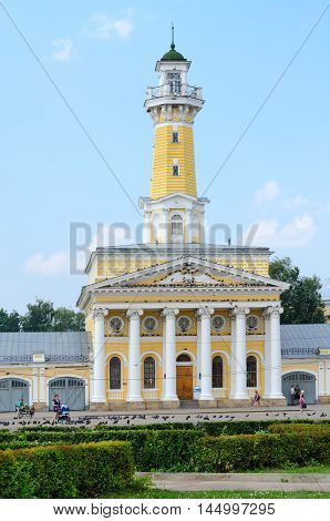 KOSTROMA RUSSIA - JULY 20 2016: Unidentified people walk on Susaninskaya square near building of fire tower Kostroma Golden ring of Russia