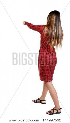 skinny woman funny fights waving his arms and legs. girl in red plaid dress punches.