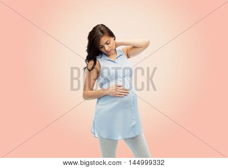 pregnancy, health, people and expectation concept - pregnant woman touching her neck and suffering from ache over beige background