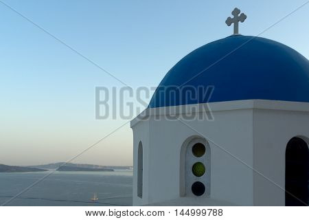 Twinlight view of Church with blue roof in town of Oia and panorama to Santorini island, Thira, Cyclades, Greece