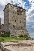 Medieval tower in  Ouranopoli, Athos, Chalkidiki, Central Macedonia, Greece poster