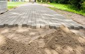construction of a new pavement of paving slabs in residental area poster
