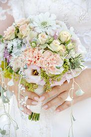 Wedding theme, bride holding a wedding bouquet