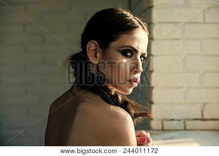 Beauty, Hairdressing Salon. Girl With Braid Hair At Window. Woman With Makeup Face On White Brick Wa