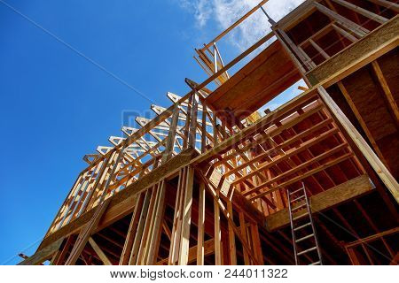 Framing Of A House Closeup New Stick Built Home Under Construction Under Blue Sky Construction And R