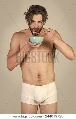 Healthy Eating. Sexy Man With Muscular Body Eating Cereal, Healthcare. Food And Beauty, Health. Morn