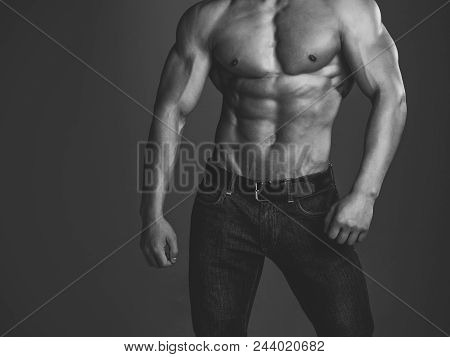 Sexy Gay. Athletic Bodybuilder Man On Grey Background. Sport And Workout. Dieting And Fitness. Man W