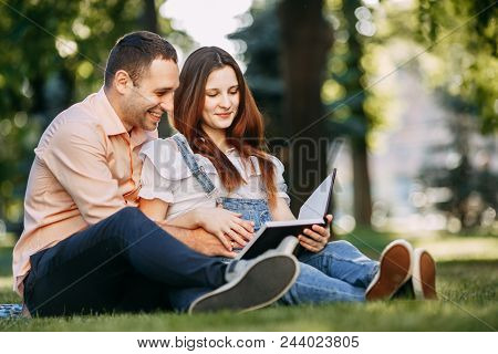 Happy Parenthood, Expecting A Baby. Pregnant Couple Enjoy Time Together At Park. Pregnancy, Partner