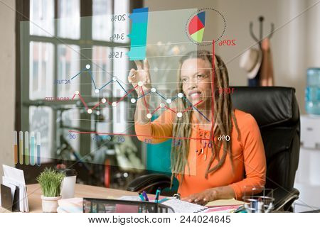 Woman In Office Manipulating A Futuristic Financial Chart
