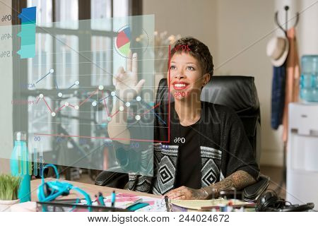 Woman Accessing Financial Information From A Futuristic Chart