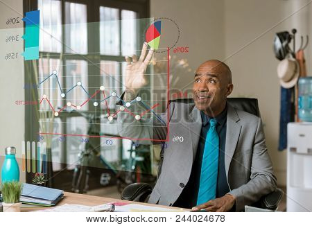 Business Man Using Futuristic Financial Chart In His Office