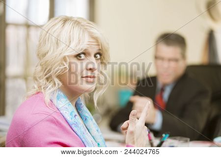 Blond Woman Gesture Towards Incompetent Male Colleague