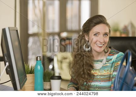 Stylish Creative Professional Woman In Her Office