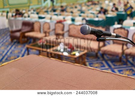 Close Up Microphone Have Participant In Conference Room As Background