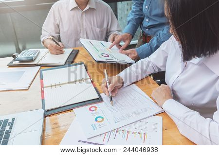 Business And Finance Concept Of Office Working,teamwork Of Businessmen Discussing Business Plan In O