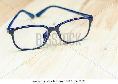Modern Eye Glasses On Wood Background. Blue Glasses. Glasses On Wood Table. Glasses For Design. Glas