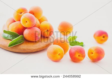 fresh apricots on white background - fruits and vegetables