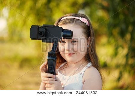 Girl With A Camera And Stabilizer Removes.
