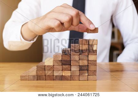 The Way Planning For Business Growth With Wooden Blocks, Hand Of Business Man Is Putting Wooden Bloc