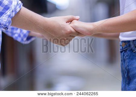 Happy Couple Holding Hands Promise Or Swear. Man Woman In Love Trust And Support Together Conceptual