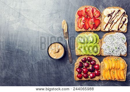 Traditional American And European Summer Breakfast: Sandwiches Of Toast With Peanut Butter, Berries