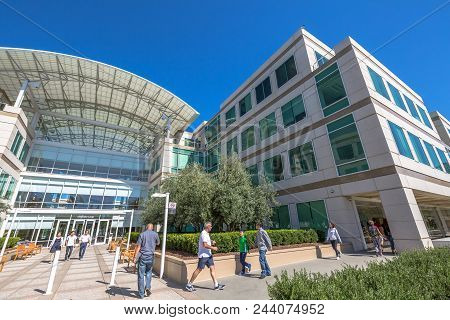 Cupertino, Ca, Usa- August 15, 2016: People Walk In Front Of The Apple Headquarters At Cupertino. Ap