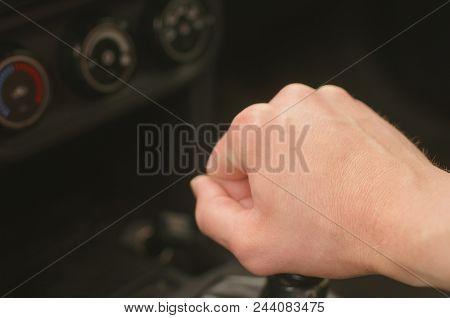 Driver Hand On Gear Shift Knob. Car Travel Concept.
