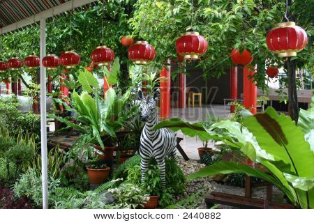 A zebra statue stands guard in a Chinese garden poster