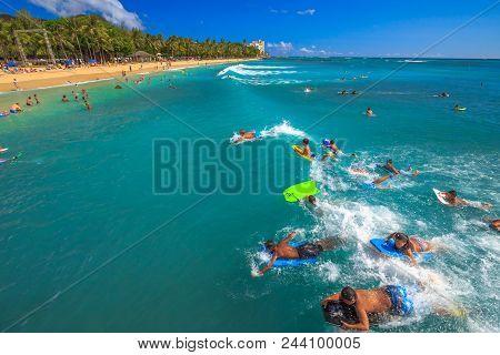 Waikiki, Oahu, Hawaii, Usa - August 27, 2016: Body Boarding Is A Popular Water Sport In Waikiki Area
