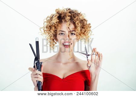 Smiling girl with curly hair holds hairdresser equipment. Hairdresser. Beauty and style. Beauty industry profession. Makeup and cosmetics for skincare. Isolated on white background. poster