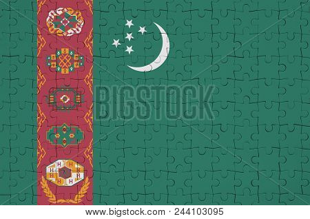 Turkmenistan Flag  Is Depicted On A Folded Puzzle