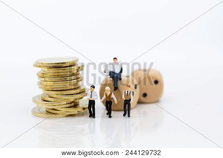 Miniature People : Businessman With Dice And Stack Of Coins. Image Use For To Solve Problems, Risk M
