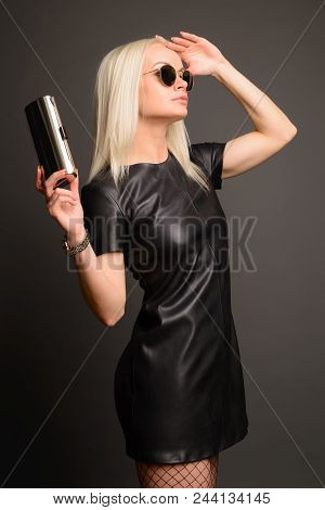 Elegance Stylish Woman In Black Leather Dress With Small Silver Bag And Watch. Fashion Concept.