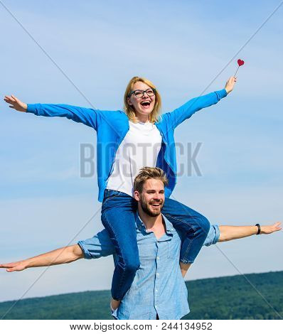 Freedom Concept. Couple In Love Enjoy Feeling Freedom Outdoor Sunny Day. Man Carries Girlfriend On S