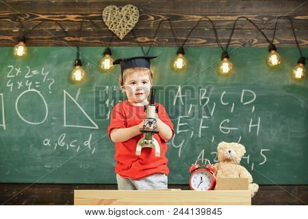 Smart Kid Concept. First Former Interested In Studying, Learning, Education. Child On Happy Face Hol