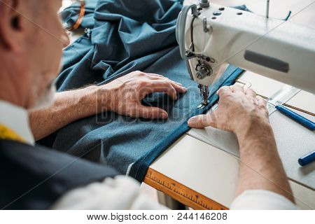 Cropped Image Of Tailor Sewing Cloth With Sewing Machine At Sewing Workshop