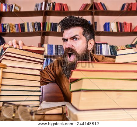 Teacher Or Student With Beard Sits At Table With Glasses, Defocused. Mad Scientist Concept. Man On S