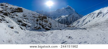 Panorama Of Snow And Mountain Range Landscape With Blue Sky From Annapurna Range, Nepal Himalayas