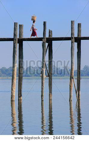 Amarapura, Myanmar - December 31: An Unidentified Woman Walks On U Bein Bridge On December 31, 2011