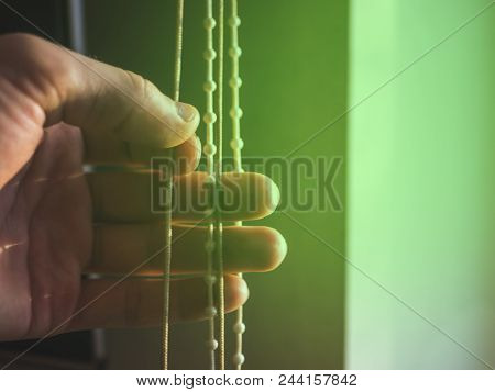Close Up Hand Pulling Ropes And Opens Window With Jalousie