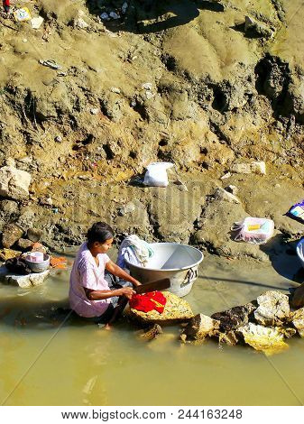 Mandalay, Myanmar - December 30: Unidentified Woman Washes Clothes In Ayeyarwady River On December 3