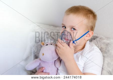 Young Boy Have Problems With Asthma And He Use Inhaler For Easing Cough