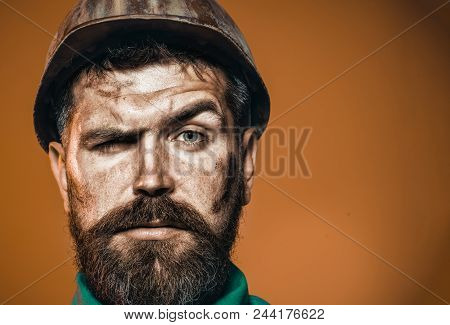 Bearded Builder In Hard Hat. Portrait Of Serious Handsome Engineer. Mechanical Worker In Protective