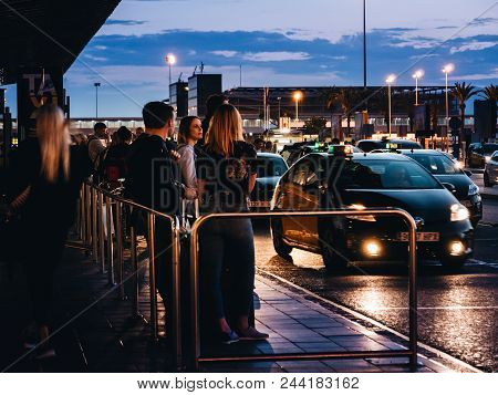 Barcelona, Spain - May 31, 2018: International Tourists And Visitors Of Barcelona Waiting For The Ta